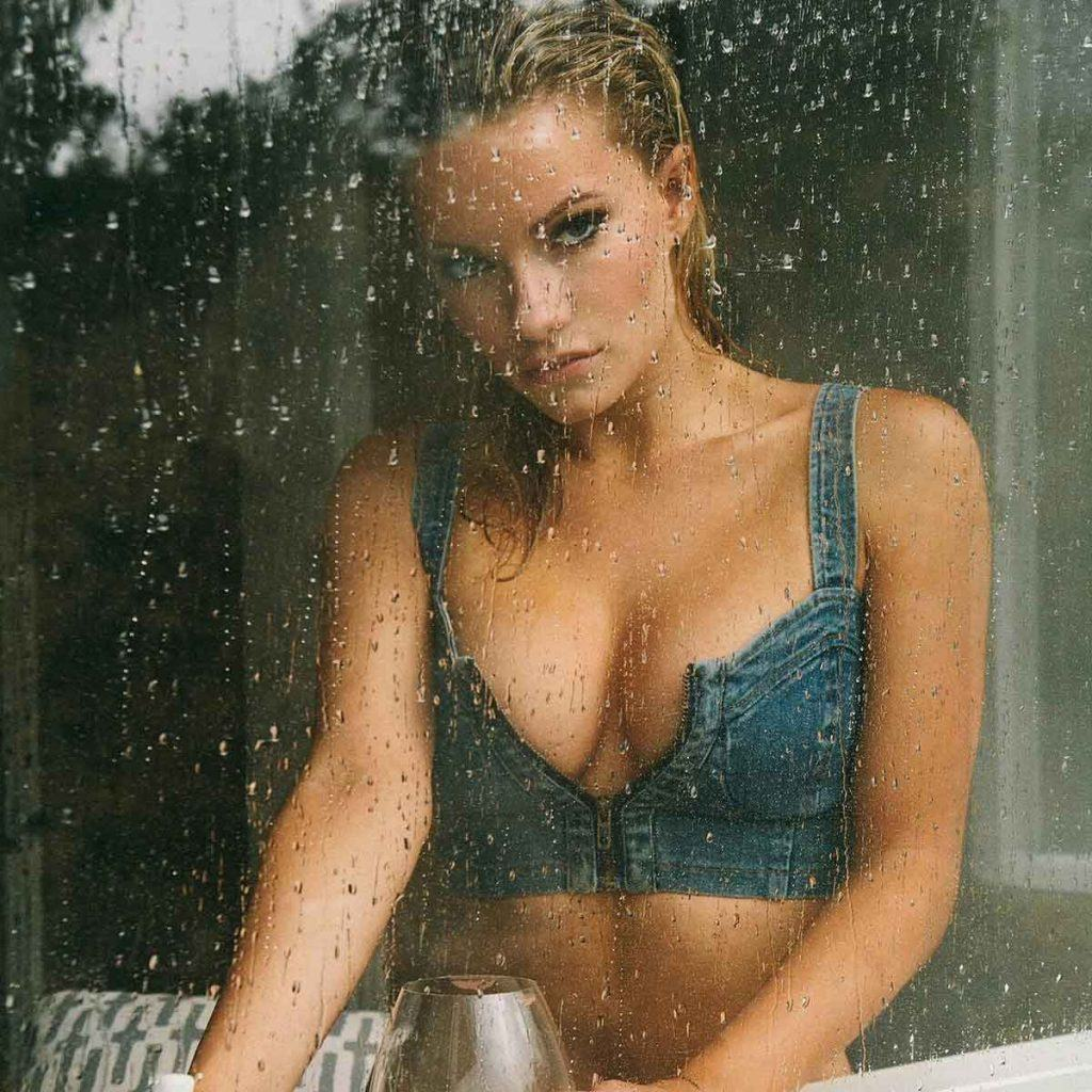 Caitlin O'Connor behind rain