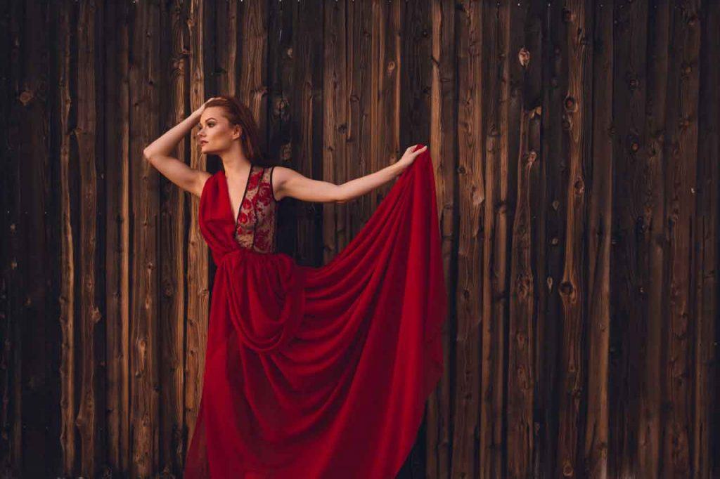 Caitlin O'Connor flowing red dress